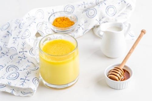 Chữa đau dạ dày bằng nghệ tươi và mật ong
